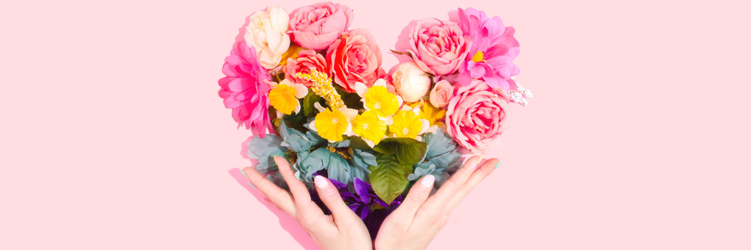 Flower heart surrounded by hands